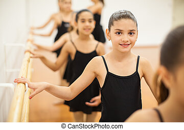Pretty Latin girl enjoying her dance class