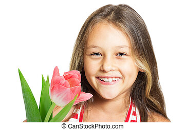 pretty laughing little girl with tulips on a white background is