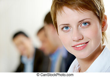 Pretty leader - Image of pretty business woman looking at...