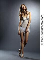 Pretty leggy model posing in erotic negligee