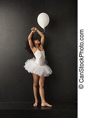 Pretty little ballet dancer with a ballon