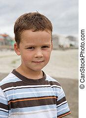 Pretty little boy on beach