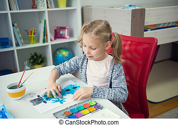 Pretty little child girl painting with colorful paint at ...