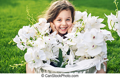 Pretty little daughter holding a flower basket