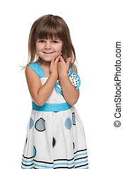 Pretty little girl against the white