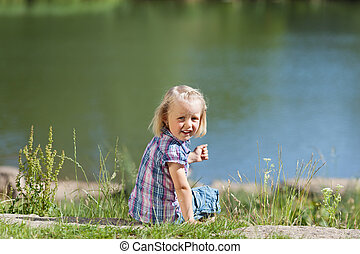 Pretty little girl at the lake