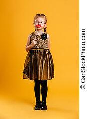 Pretty little girl child holding fake lips.