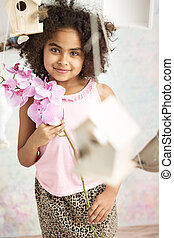 Pretty little girl holding a flower
