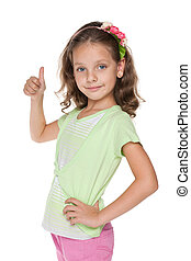 Pretty little girl holds her thumb up