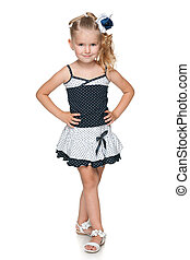 Pretty little girl in a fashion dress