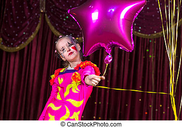 Pretty little girl in a festive costume