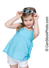 Pretty little girl in a polka dot blue dress