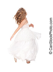 pretty little girl in beautiful white dress in movement