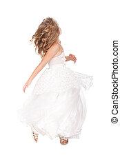 pretty little girl in beautiful white dress in movement