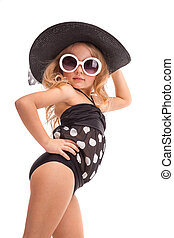 Pretty little girl in in black swimwear, white sunglasses and black hat