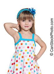 Pretty little girl in polka dot dress