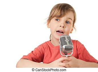 pretty little girl in red T-shirt sing in old style microphone isolated on white background, looking aside