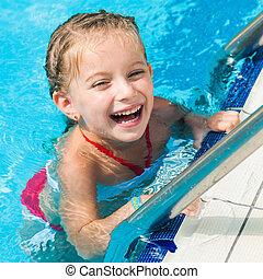 pretty little girl in swimming...