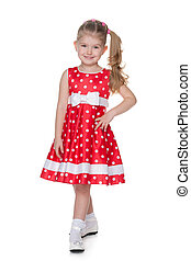 Pretty little girl in the polka dot dress