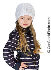 Pretty little girl in the winter clothes