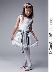 Pretty little girl in white dress