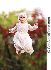 Pretty Little Girl Jumping High as if Flying