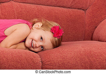 Pretty little girl on the sofa