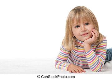 Pretty little girl on the white carpet