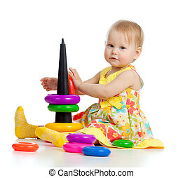 pretty little girl playing with color toy