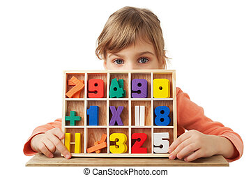 pretty little girl plays in wooden figures in form of numerals isolated on white background