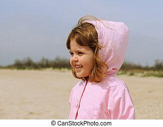 Pretty little girl portrait on the beach