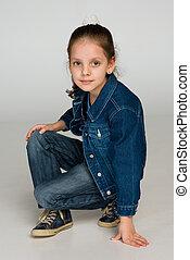 Pretty little girl sits