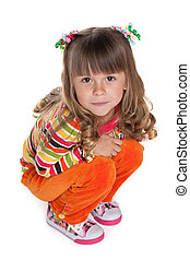 Pretty little girl sits on the floor