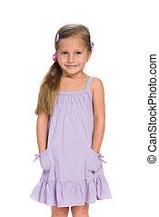 Pretty little girl stands