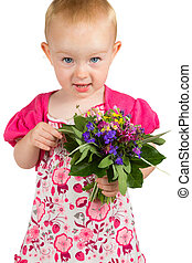 Pretty little girl with a bunch of garden flowers