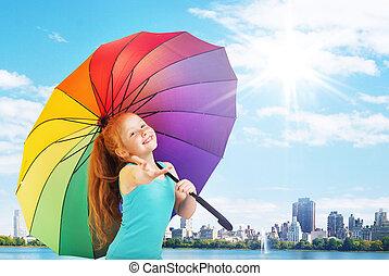Pretty little girl with an umbrella