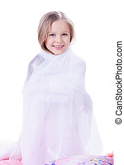Pretty little girl with blanket