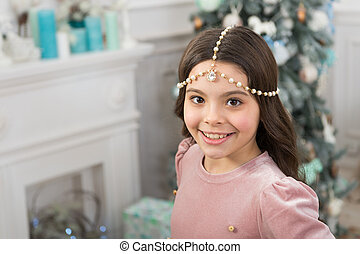 pretty little princess celebrate christmas. smiling cute child at home. happy new 2020 year. holiday party celebration. christmas home decoration. xmas shopping time. awaiting new year