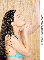 Pretty long hair woman having a shower