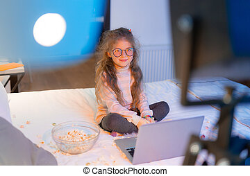 Pretty long-haired girl in big eyeglasses looking relaxed