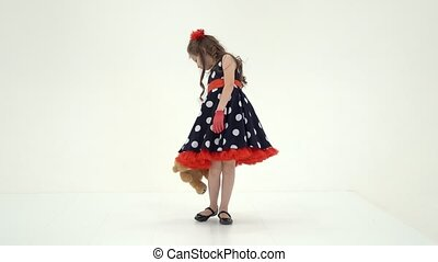 Pretty Long Haired Girl Wearing Polka Dot Dress Posing with ...