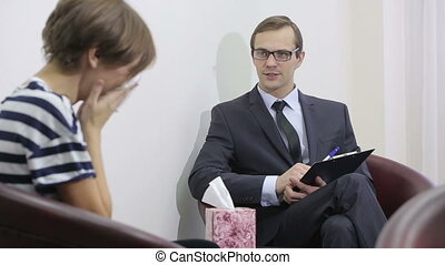 pretty male psychiatrist looking at patient during her visit