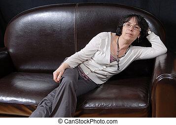 pretty mature woman sitting on a sofa