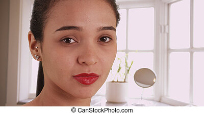 Pretty Mexican woman looking at camera