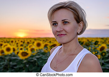 Pretty middle-aged blond woman in the country
