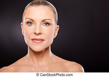 middle aged woman on black background
