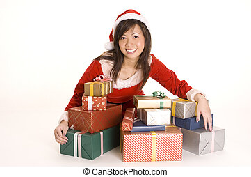 Pretty Miss Santa - A cute asian woman dressed as santa sits...