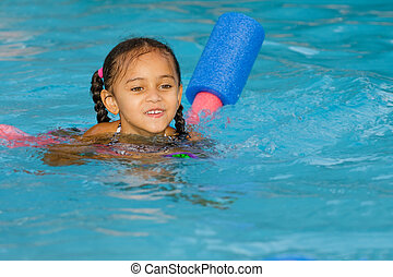 Pretty mixed race child swimming