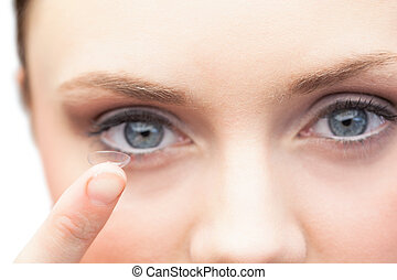 Pretty model holding contact lens