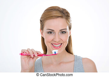 pretty model holds toothbrush